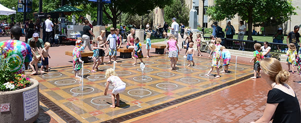 Kids Playing Pop Jet Fountains on Pearl Street