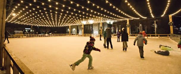 People ice skating at Winter Skate Boulder