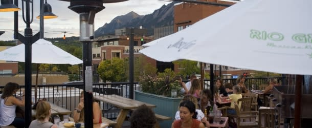 Patrons dining on the rooftop of Rio Grande in Boulder