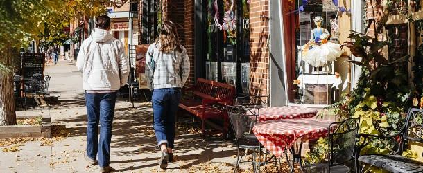 A Couple Walking Down Pearl Street