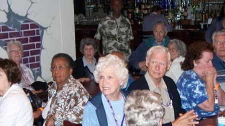 A group enjoys an SCVB wine reception at their hotel.