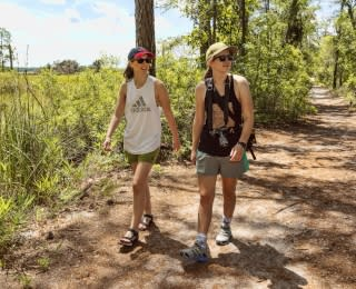Two women hiking in Carolina Beach State Park
