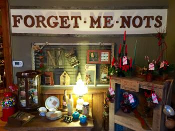The wood lettering of the Forget-Me-Nots sign inside the shop is the same wood lettering that was used by Cindy Petty's mother in her own shop of the same name in the same location.
