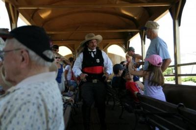 Professional Reenactors, like this train robber from The Congressional Gunfighters of America, can add to your group's experience.