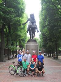 Bicyclists in front of Paul Revere statue