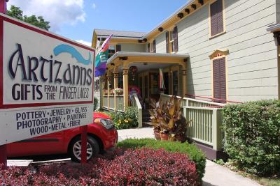 artizanns-naples-exterior-sign-porch-bushes