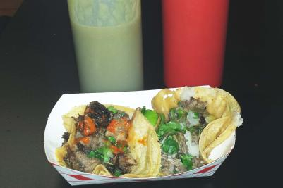 Taqueria Tepito lengua and brisket tacos with the devilish red and green sauces.