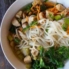 Chicken and rice noodle broth bowl