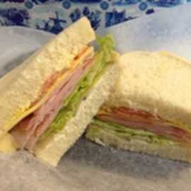 The Munich Sandwich; Canadian Bacon (Kassler) and Mild Farmers Cheese Half $4.99, Whole  $7.45