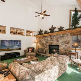 Main living room with toasty gas fireplace and 75