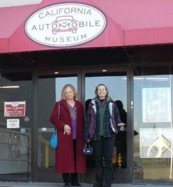 Janet and Carol pose at the entrance to the California Automobile Museum