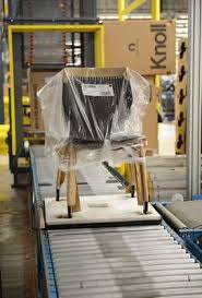 A chair crosses the assembly line of the Knoll Furniture factory