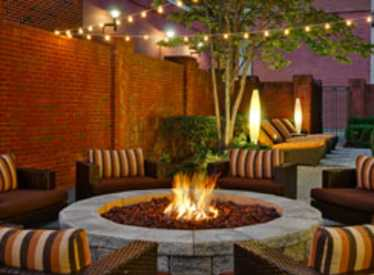 Outdoor area with firepit at Courtyard/Downtown