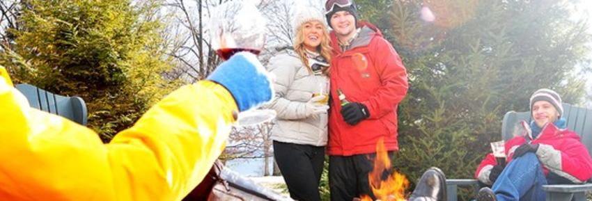 finger-lakes-belhurst-geneva-winter-outside-group-by-fire-pit__552xXXX