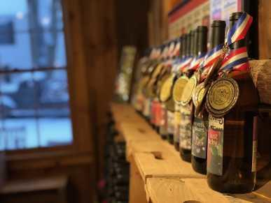 Holiday Wine Trail award-winning wines on mantel at Terhune Orchards
