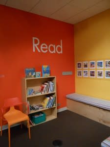 Bright colors, books and a bench or two - what more could you ask for in a reading corner?