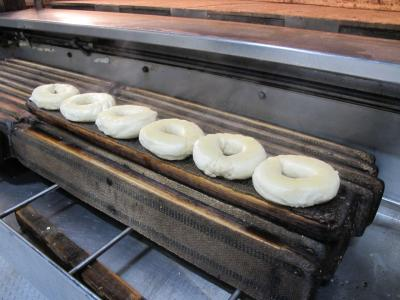 Fresh bagels in dough form ready to be prepared at Sammy's New York Bagels