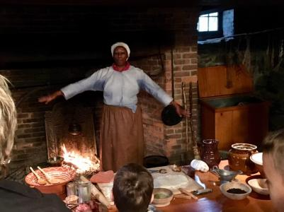 Lavada Nahon demonstrates historic cooking in the Crailo State Historic Site at Pinkster Festival celebration.