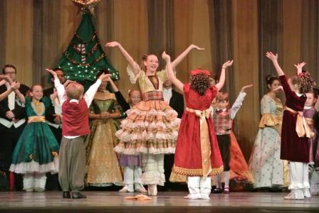 Wilmington Ballet Co. Nutcracker Performers with hands raised