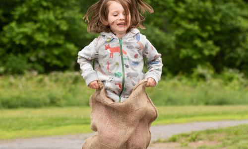 Saratoga Independent School girl in sack race