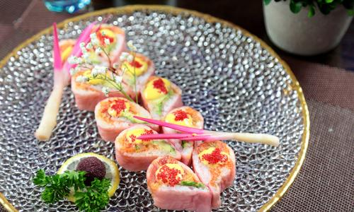 Wasabi Restaurant specialty roll laid flat on plate