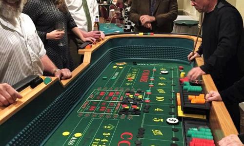 Alpine Amusement Group around craps table