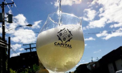 Capital Craft Beverage Trail wineglass under sunny sky