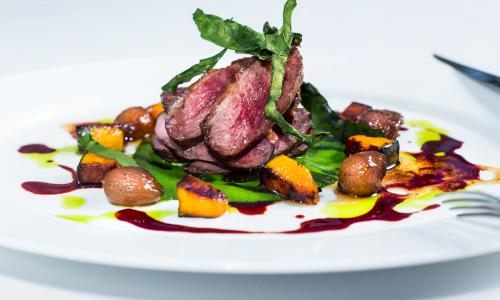 The Blue Hen dinner plate with beef dish