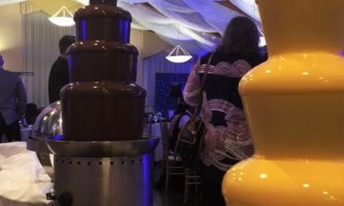 We Do Fondue Dark and white chocolate fountains under tent