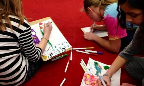 Saratoga Arts Center Kids coloring on carpet
