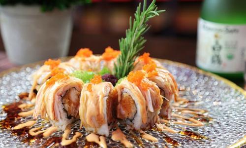 Wasabi Restaurant specialty roll arranged with sprig