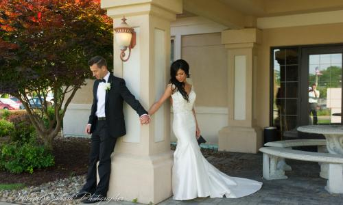 Mallozzi's Catering bride and groom around pillar for reveal