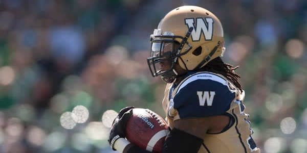 Winnipeg Blue Bombers player with football