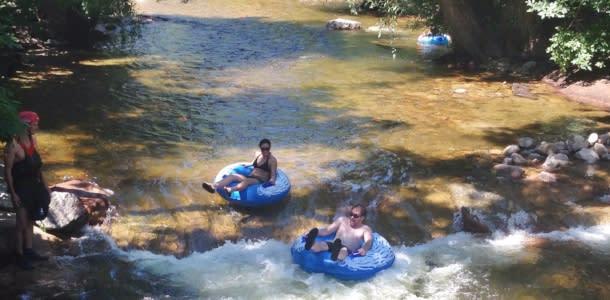 Man and woman tubing Boulder Creek