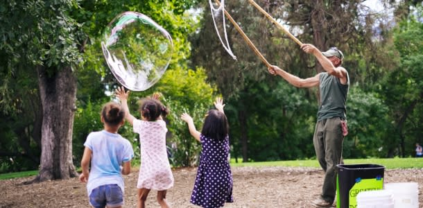 Kids Chasing Giant Bubble