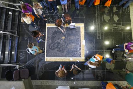 visitors work together on large art projects at Imagine RIT