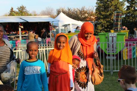 A family enjoys the fun rides and attractions at the Rochester Lilac Festival