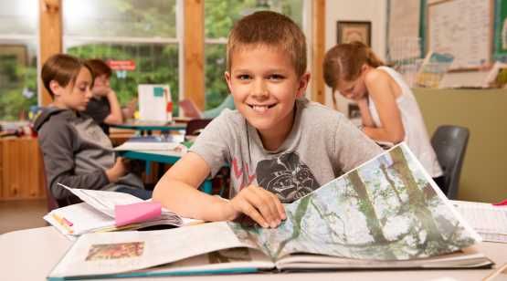 Saratoga Independent School boy with book