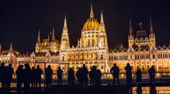 Playbill Travel shot in Budapest with silhouetted people