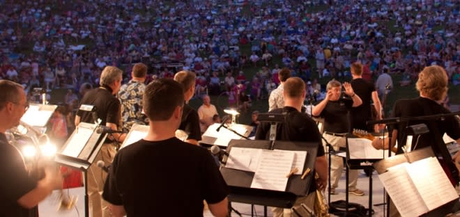 Kentucky Symphony Orchestra performing at Devou Park Bandshell under the night sky