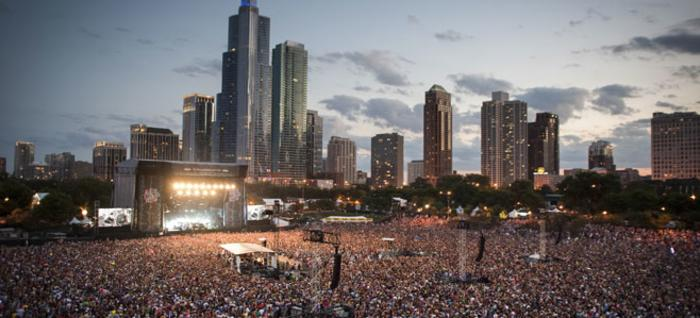 Aerial view of Lollapalooza with Chicago skyline in the background.