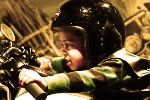 Kid on motorcycle at the Strong National Museum of Play