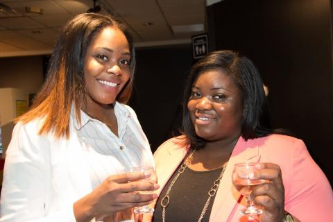 Two women toast at the Uncorked event at the Rochester Museum & Science Center