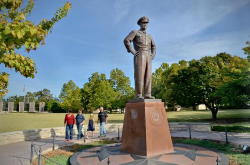 Family walks around a Statue of Dwight D. Eisenhower at the Presidential Museum in Abilene