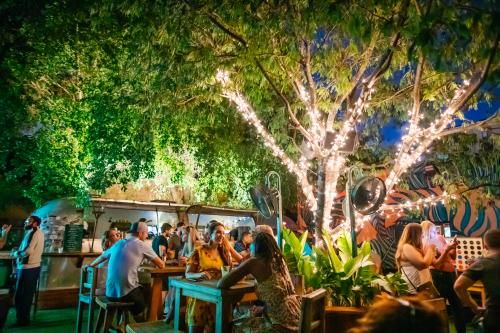 Rhythm & Vine Beer Garden is a bar that features a different food truck every night, an airstream bar, and wooden picnic tables for groups of friends to eat, mingle and play fun games like Jenga.
