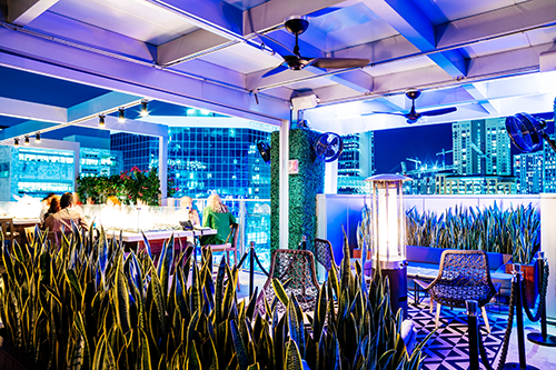 Rooftop @ 1WLO in Fort Lauderdale serves handcrafted cocktails above Las Olas Boulevard and the New River.