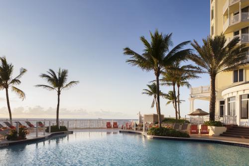The pool at Pelican Grand Beach Resort