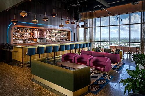 Sparrow is rooftop restaurant and bar with a groovy '60s flair and inside-outside seating.