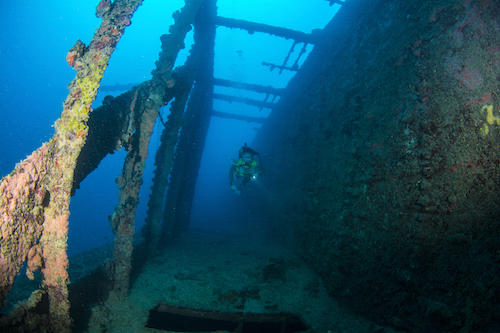 Diver swims down the starboard passageway