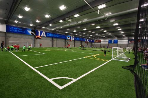Youth soccer practicing indoors